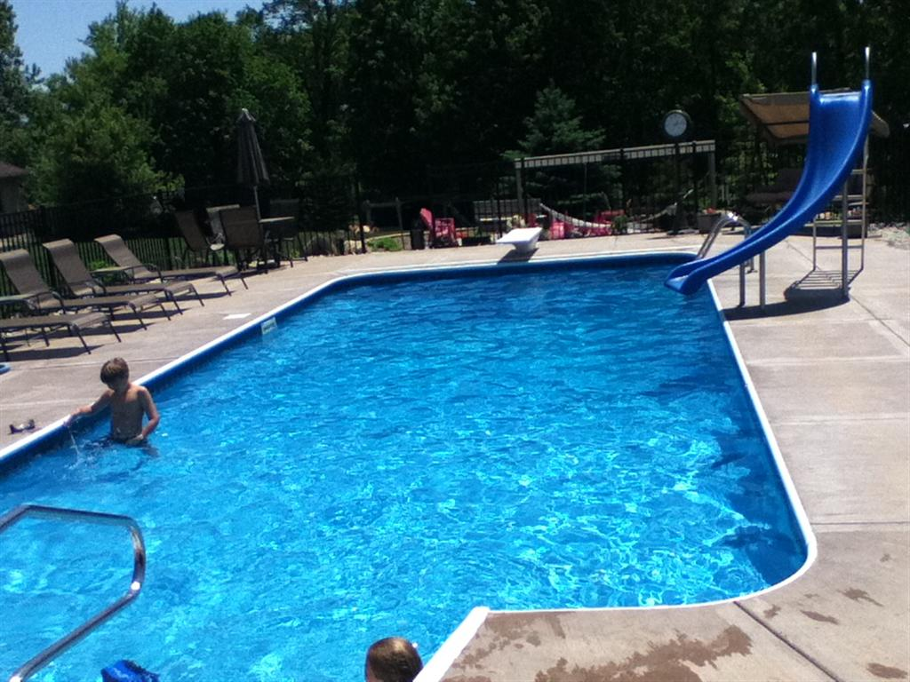 Huge Backyard Slide : here is the same pool with a larger shallow end both meet