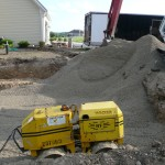 As you Fill in the Hole, Water and Compact Down the Stone Every 8″. By Compacting the Stone, We are Creating Virgin Ground to Place your Pool Walls on.  A Trench Compactor is the Best Compactor to use for this Project.