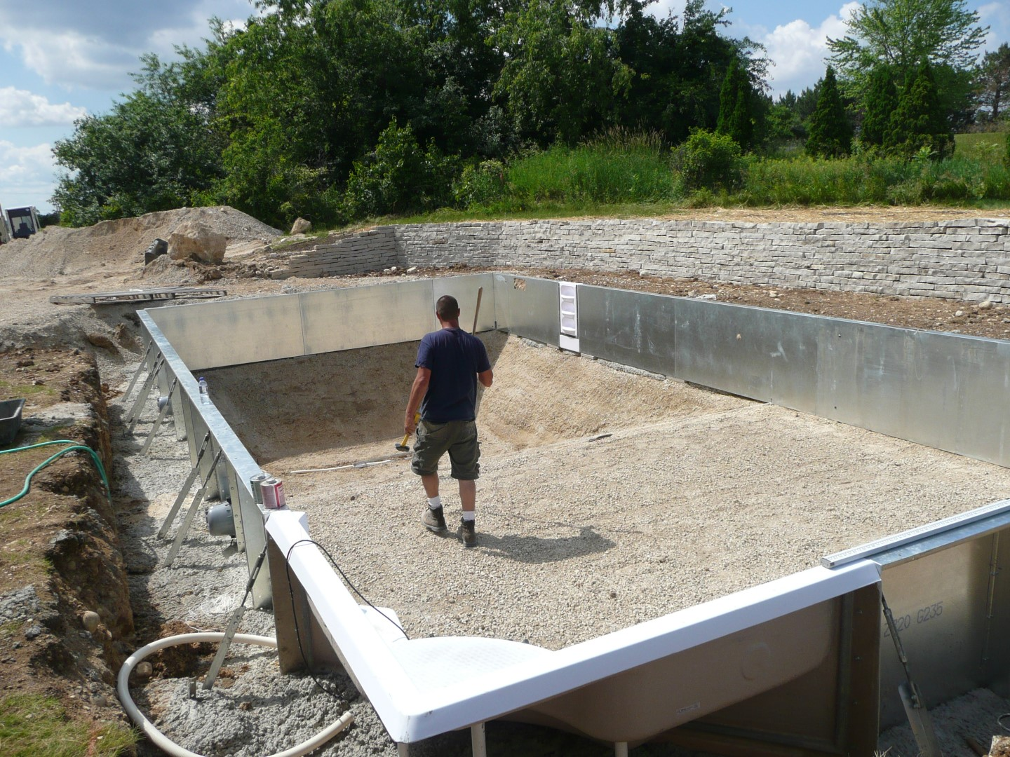 Building an vinyl liner inground swimming pool on rock for Building a swimming pool