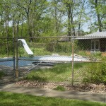 Old Chain Link Fence around Concrete & Fiberglass Pool