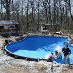 Polymer FreeForm Swimming Pool gets Water Added