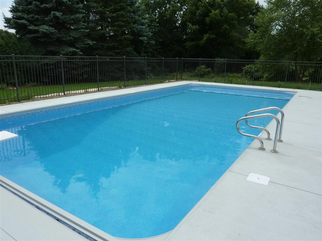Penguin pools fencing decking options for Concrete swimming pool