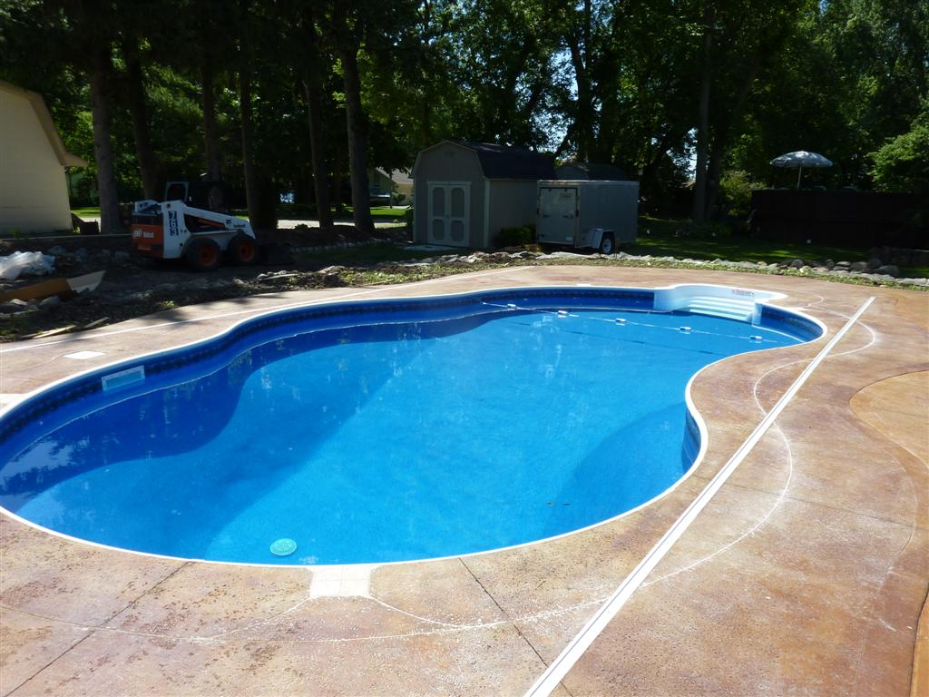 Completed inground swimming pools landscaping for Concrete swimming pool