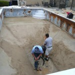Old Pool Liner Taken and Water Drained Out in Sand Pool Bottom