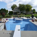 Swimming Pool Design with Island in Shallow End