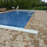 Basic Pavers Around Inground Swimming Pool with Auto Cover