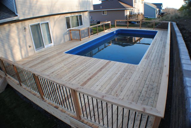 Completed inground swimming pools landscaping for Wood pool deck design