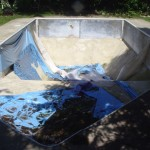 Old Swimming Pool with Ripped Vinyl Liner
