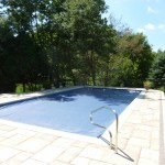 Stone Around Auto Cover Pool in Greendale, WI