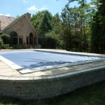 Mini Retaining Wall Around Swimming Pool with Auto Cover