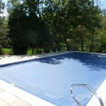 Navy Blue Auto Cover with Paver Surround Pool