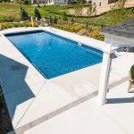 Stone Accents with Cantilevered Swimming Pool Concrete