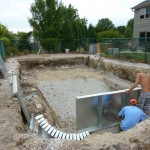 Stone Base in Pool Prior to Steel Walls getting Installed in New Berlin