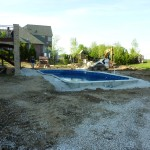Stone Backfill Pur around Free Form Pool in Franklin WI