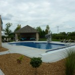 Tan Stone Landscaping Around Swimming Pool Install