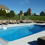 Auto Cover Swimming Pool with Rock Wall & Fencing