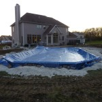 Bag Winter Cover to Protect Pool over Winter in Muskego WI