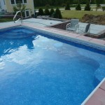 Stools in Vinyl Liner Inground Swimming Pool with Colored Concrete