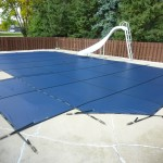 WI Custom Safety Cover on Inground Pool Pool with Slide & Step