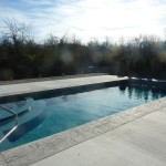 Racine, WI Fiberglass Inground Swimming Pool with Cantilevered Concrete